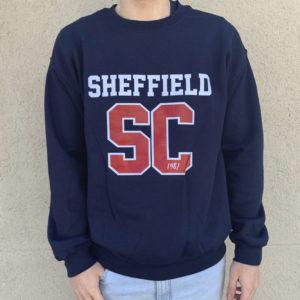 Sudadera de chico de color azul con logo SC rojo y blanco